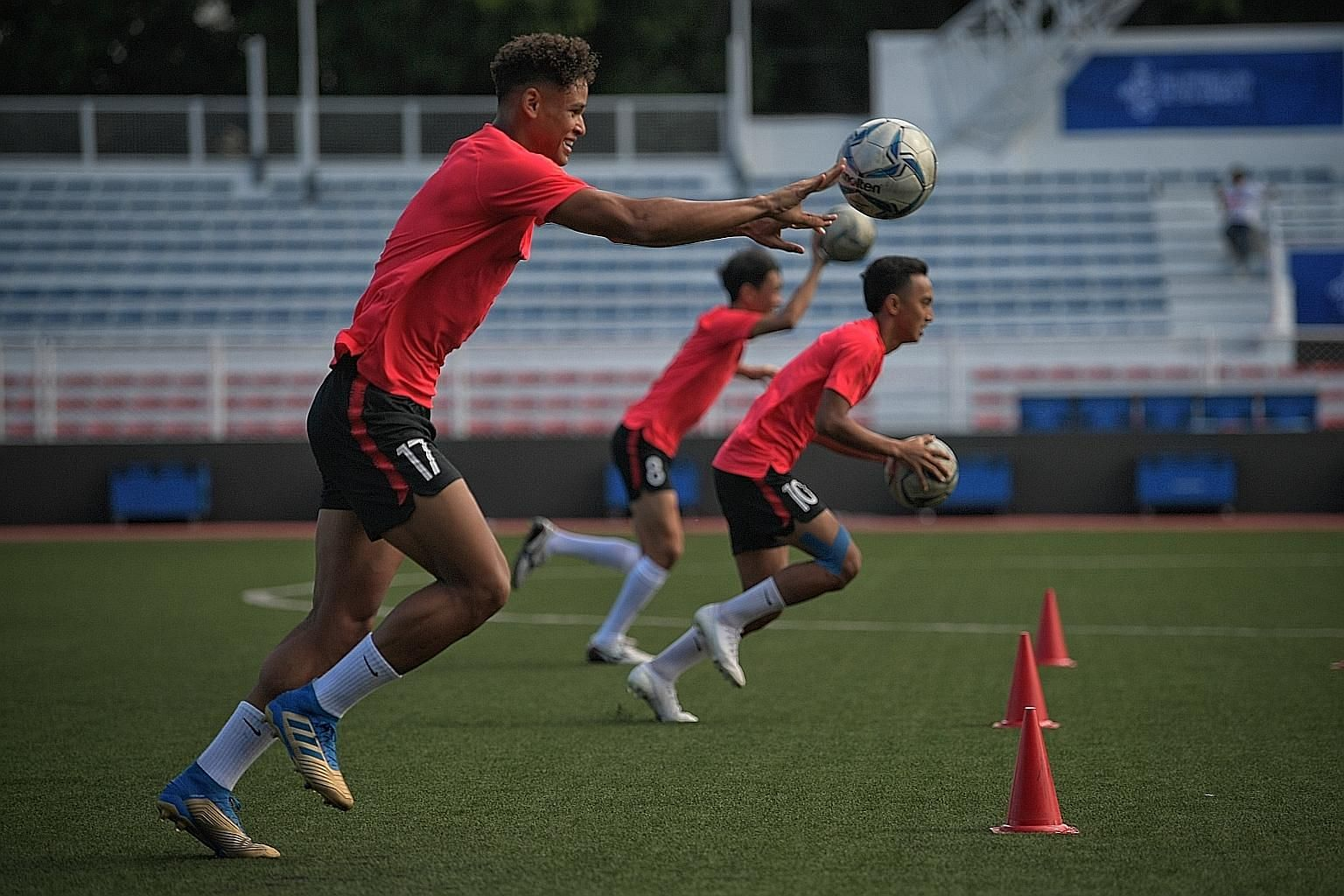 Irfan Fandi (No. 17) and Faris Ramli (No. 10) training with the Under-22 footballers at the Rizal Memorial Stadium ahead of their opening SEA Games group match against Laos tonight. ST PHOTO: MARK CHEONG