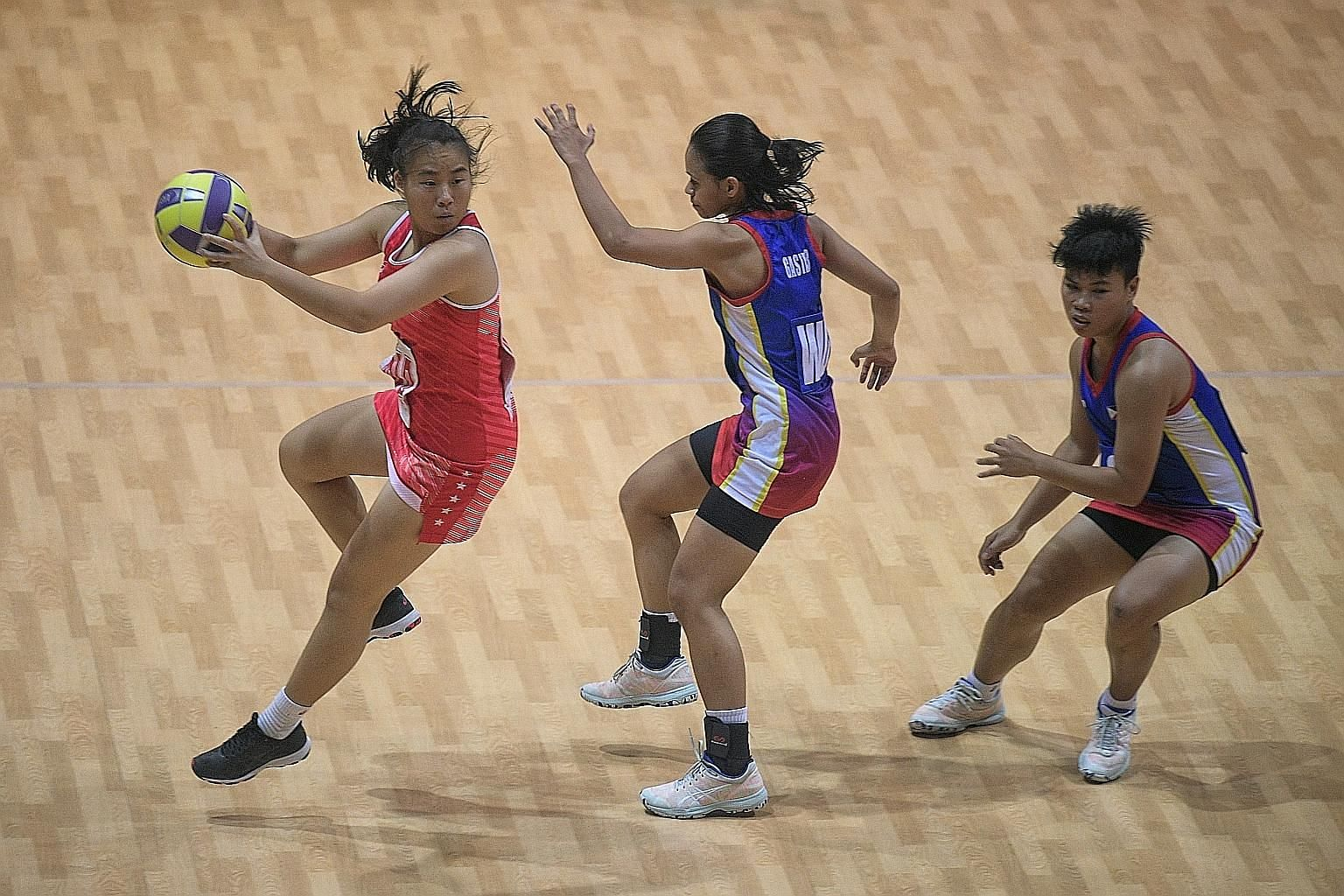 Singapore's wing attack Angelina Lim, one of two SEA Games debutantes, on the ball during the 80-28 opening win over the Philippines at the Santa Rosa Sports Complex yesterday. ST PHOTO: MARK CHEONG