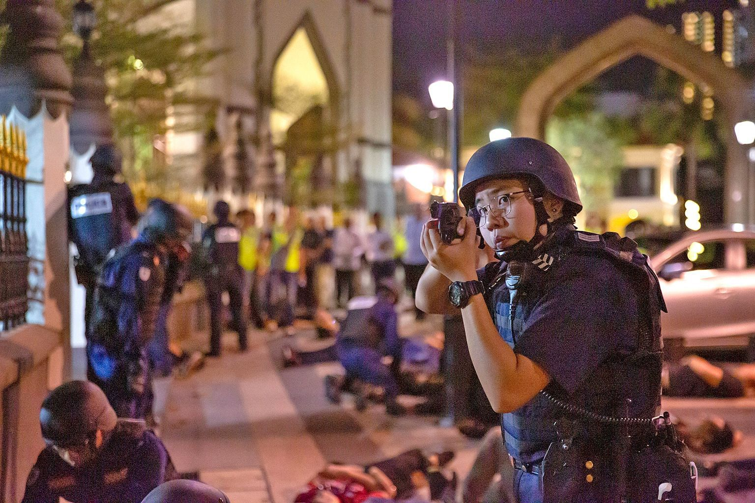 The police and the Singapore Civil Defence Force in action during the terror drill at Sultan Mosque on Sunday, as part of a series of anti-terror exercises held in various parts of Singapore.