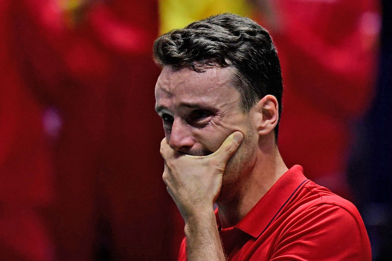 Roberto Bautista Agut cannot contain his emotions after beating Canada's Felix Auger-Aliassime during their Davis Cup final match on Sunday. The victory came three days after the Spaniard's father died. PHOTO: AGENCE FRANCE-PRESSE
