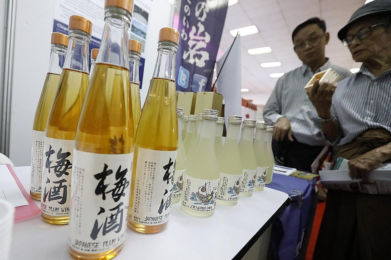 Visitors checking out Japanese sake during the 8th Japan Expo 2019 at Tatmadaw Exhibition Hall in Yangon, Myanmar, earlier this month. The humble Japanese rice drink is gaining popularity outside Japan.