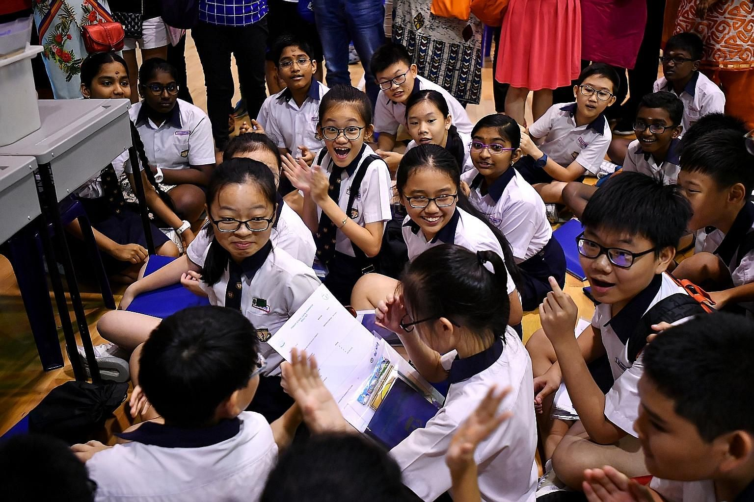Pupils reacting to the release of their Primary School Leaving Examination results at Geylang Methodist School (Primary) last year. Assessment is a key feature of education systems, says the writer, and we can lessen the anxiety and stress related to