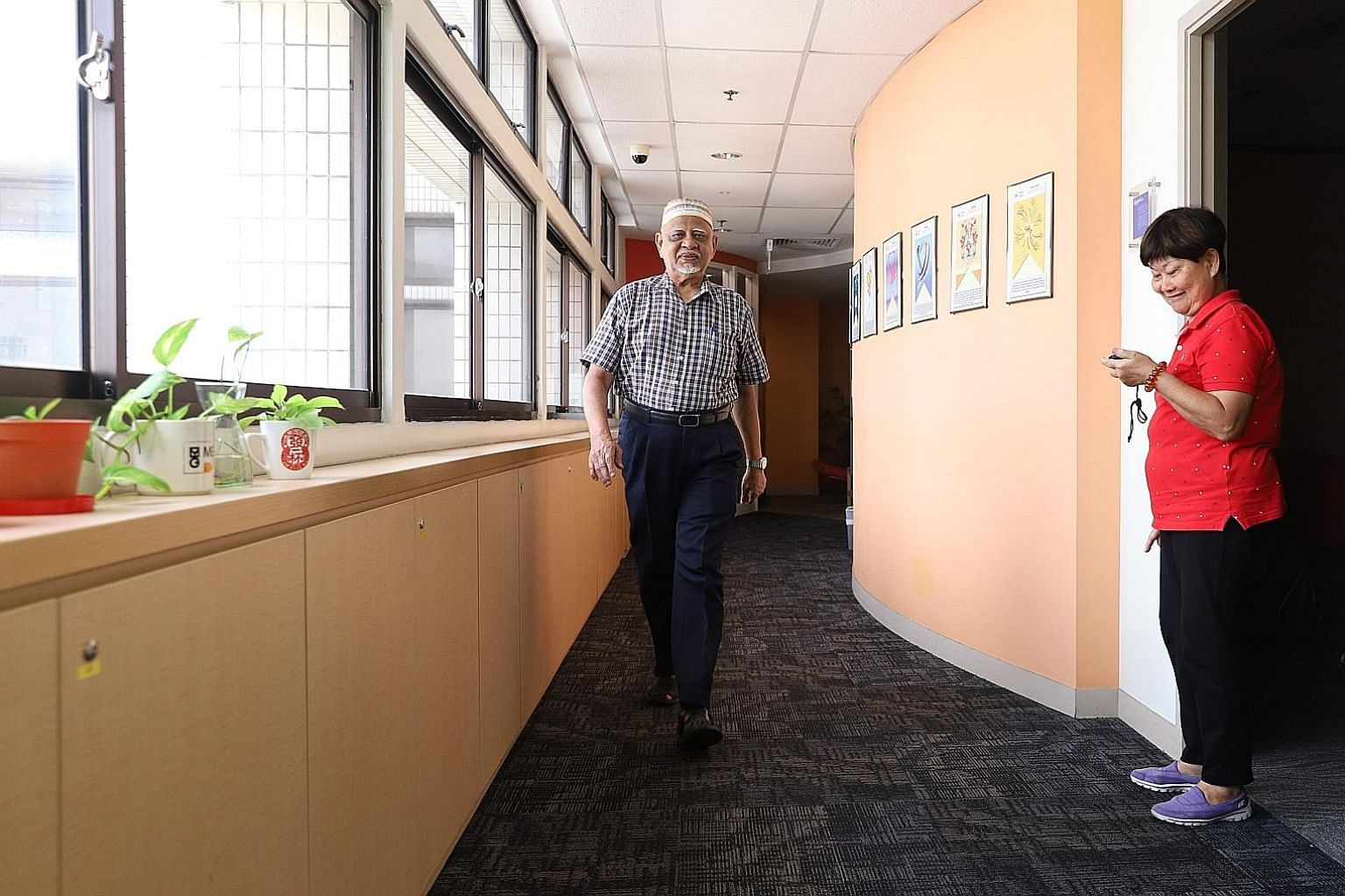 SingHealth Polyclinics clinical research coordinator Ng Chiat Eng measuring the walking speed of Mr Abdul Samad, 76, during a demonstration of sarcopenia assessment methods on Monday.