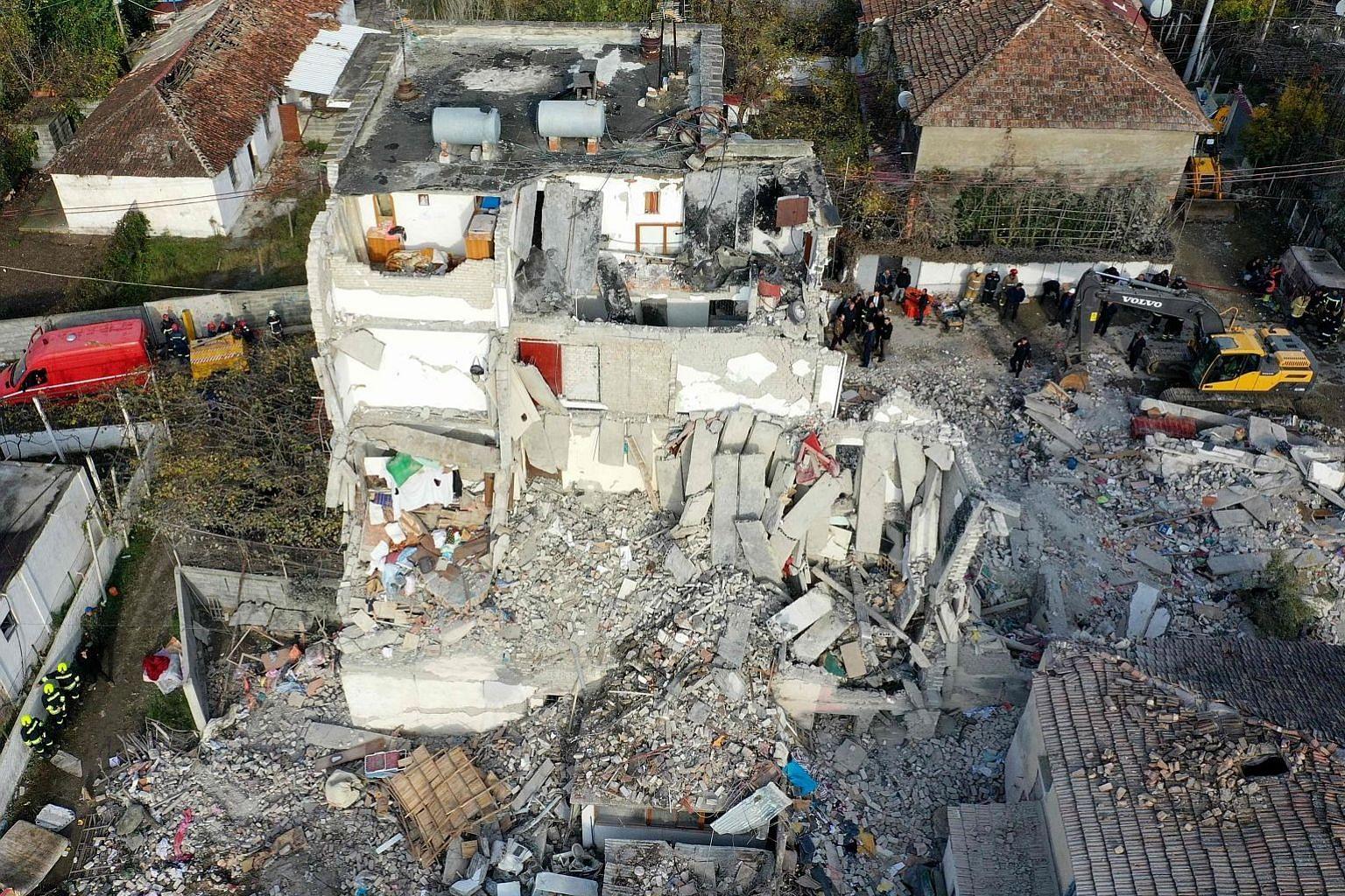 Emergency workers on the site of a collapsed building in Thumane, north-west of the capital Tirana, after an earthquake hit Albania on Tuesday. The disaster killed at least 26 people and injured more than 650. Rescue teams and other disaster experts