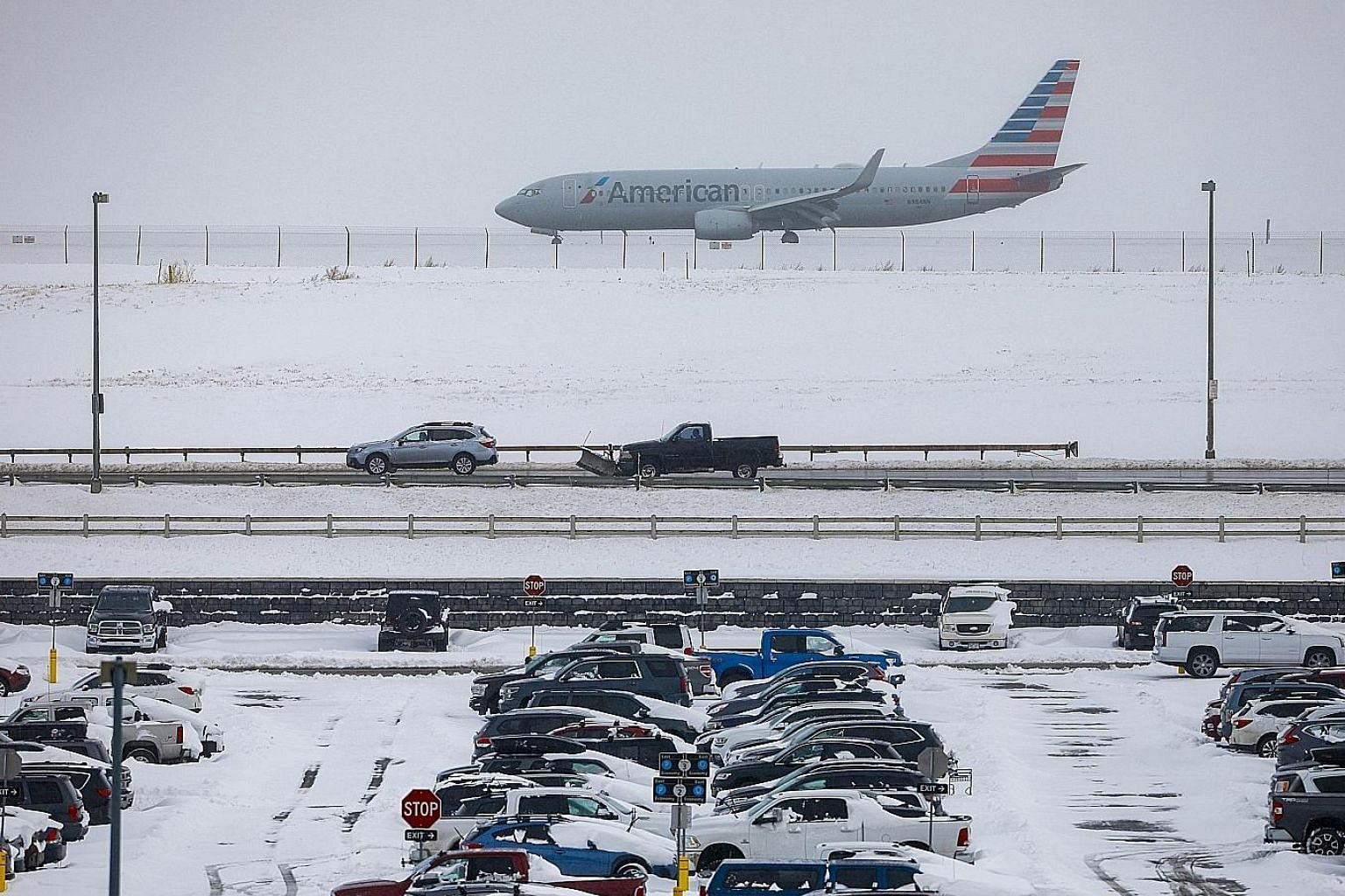 Above: Denver International Airport's Twitter account reported more than 17cm of snow early on Tuesday morning. Although the airport was still operating, more than 475 flights through Denver had been cancelled. Below: Seventeen-year-old Jordan Dickma
