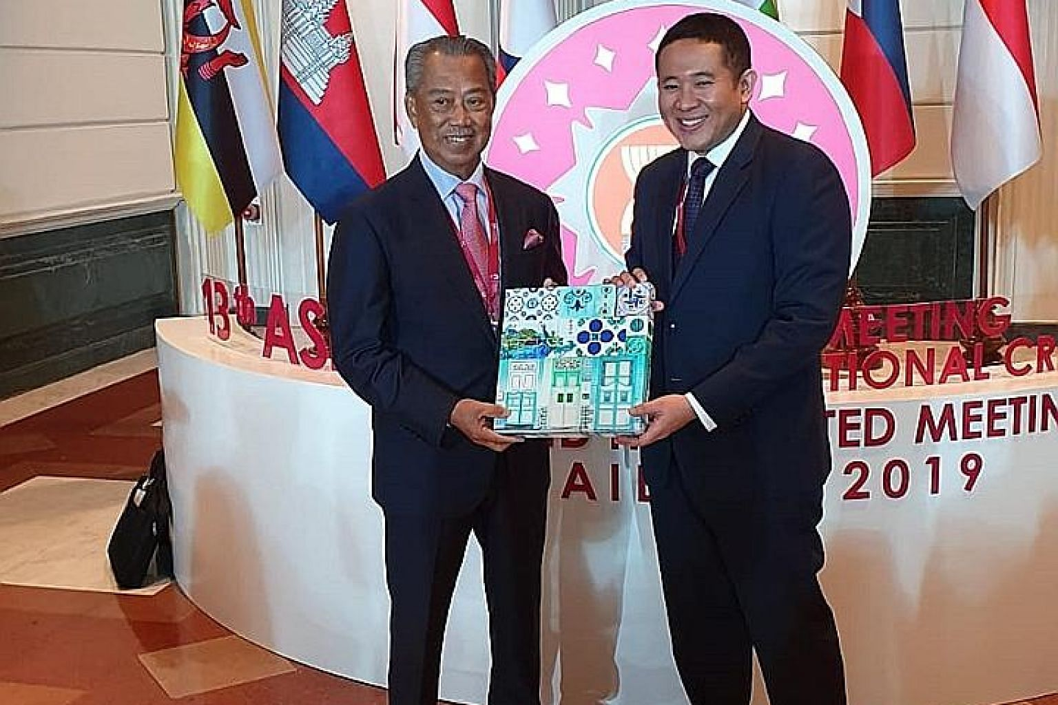 Senior Parliamentary Secretary for Health and Home Affairs Amrin Amin with Malaysia's Home Minister Muhyiddin Yassin (far left) during the 13th Asean Ministerial Meeting on Transnational Crime in Bangkok yesterday. PHOTO: MINISTRY OF HOME AFFAIRS