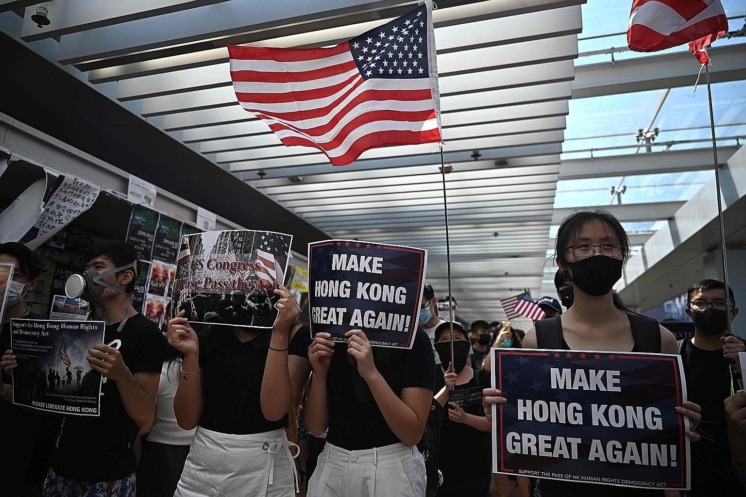 Protesters holding the US flag at the Hong Kong University campus in September as they urged the US Congress to support the Hong Kong Human Rights and Democracy Act, which has just been signed into law by President Donald Trump.