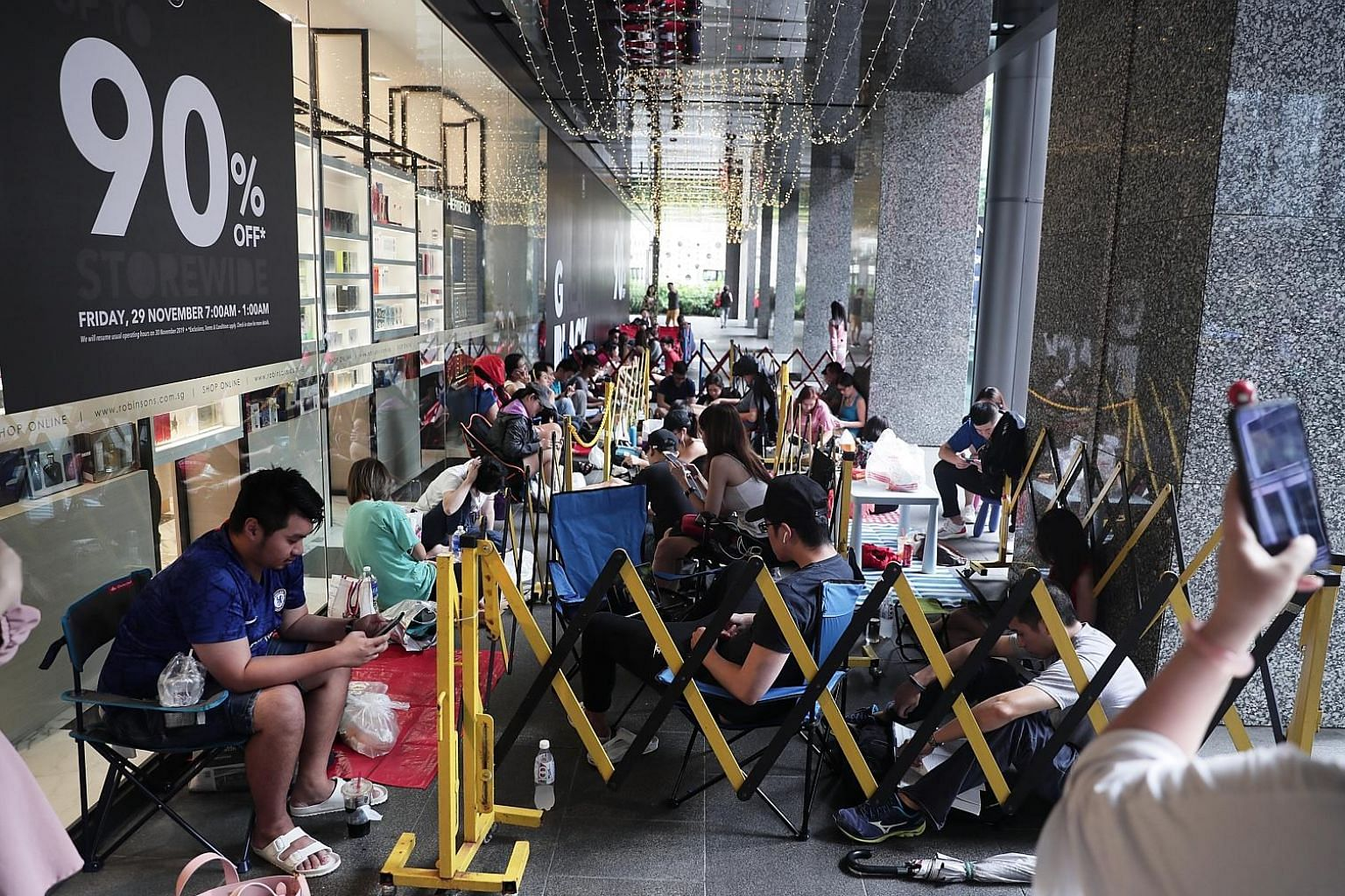 Around 50 people had parked themselves outside Robinsons The Heeren by 4pm yesterday to be among the first in line when the store's doors open at 7am today for its annual Black Friday sale, called The Great Blackout. The bargain hunters came armed wi