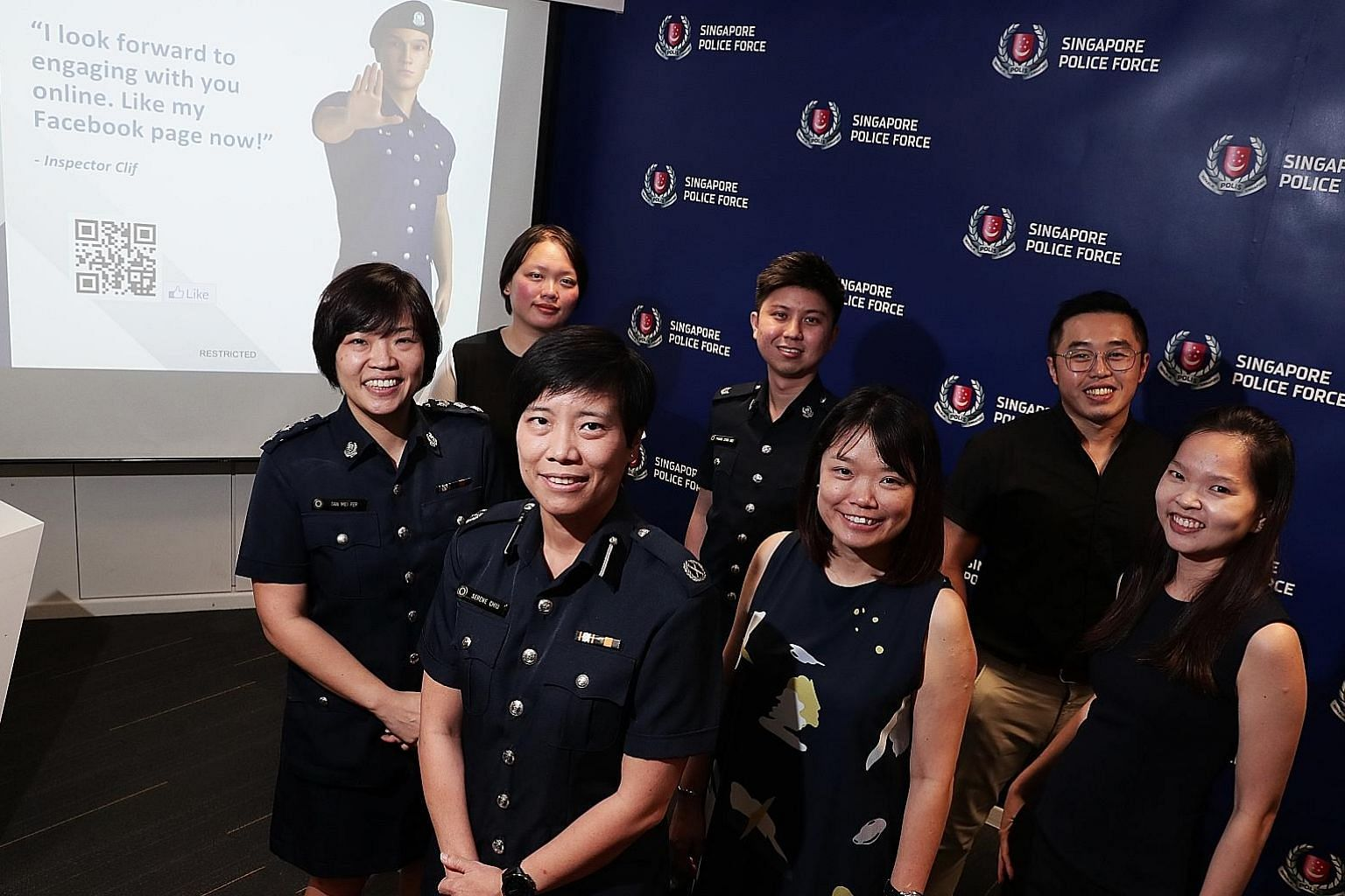 Deputy Assistant Commissioner Serene Chiu (second from left), with members of the New Media Team from the Singapore Police Force's Public Affairs Department, who are involved in the development of the online police avatar, Inspector Clif (far right).