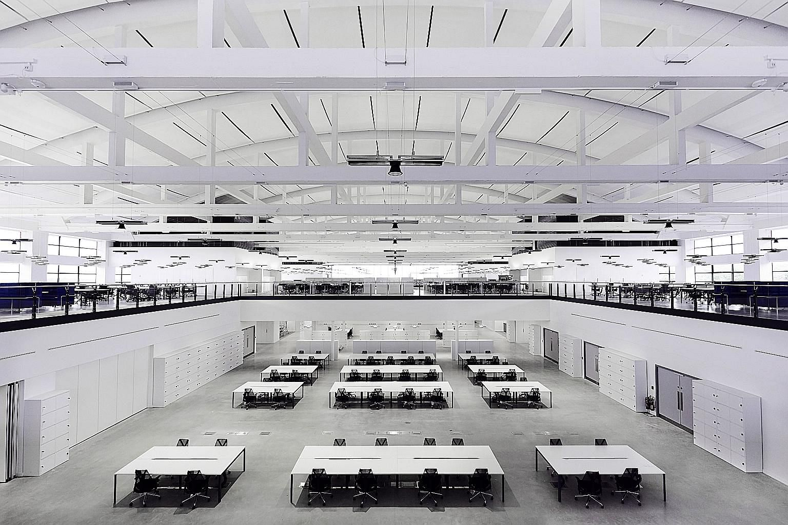 Dyson's Hullavington campus in Britain, where derelict airplane hangars were recently restored and transformed into modern workspaces. The campus had been earmarked as the development site for the firm's electric vehicle - complete with plans to inst
