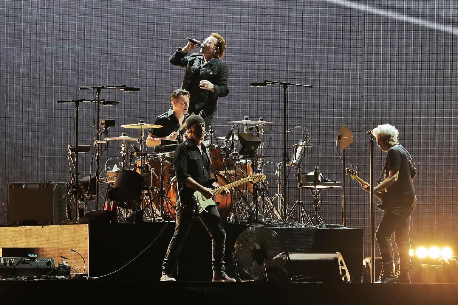 Irish rock band U2 comprising (from left) drummer Larry Mullen, guitarist The Edge, frontman Bono and bassist Adam Clayton performing at the National Stadium to a 50,000-strong sold-out crowd yesterday.