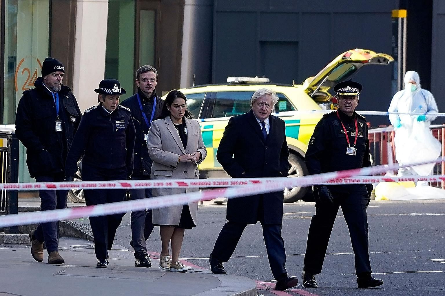 British Prime Minister Boris Johnson, flanked by Home Secretary Priti Patel and City of London Police Commissioner Ian Dyson, arriving yesterday at the scene of the attack on London Bridge. Mr Johnson cancelled his election activities yesterday so he