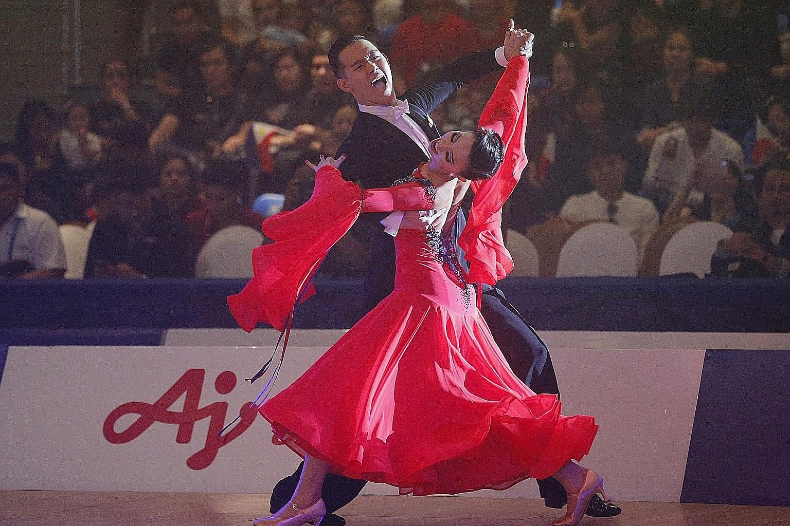 Jerome and Rachel Teo performing in the standard slow foxtrot, which won them a silver medal, after they had waltzed their way to two bronzes, one of which was Singapore's first medal at a SEA Games dancesport event.