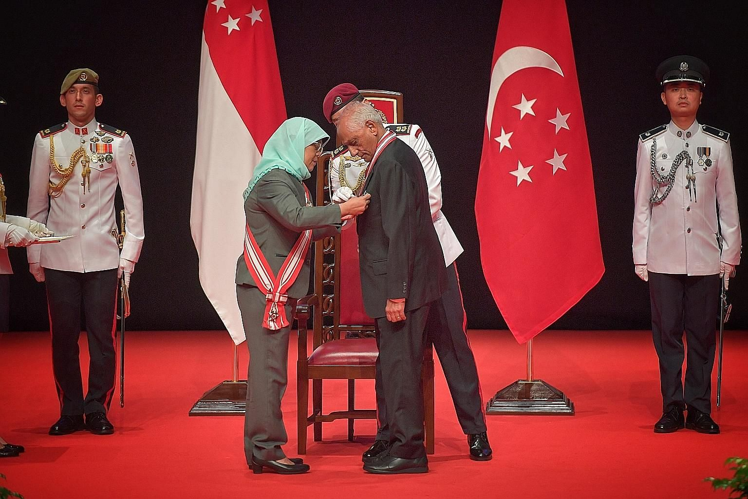 President Halimah Yacob presenting the Order of Temasek (With Distinction) to Mr J.Y. Pillay, who was the longest-serving chairman of the Council of Presidential Advisers, having led it from 2005 until January this year. ST PHOTO: ARIFFIN JAMAR
