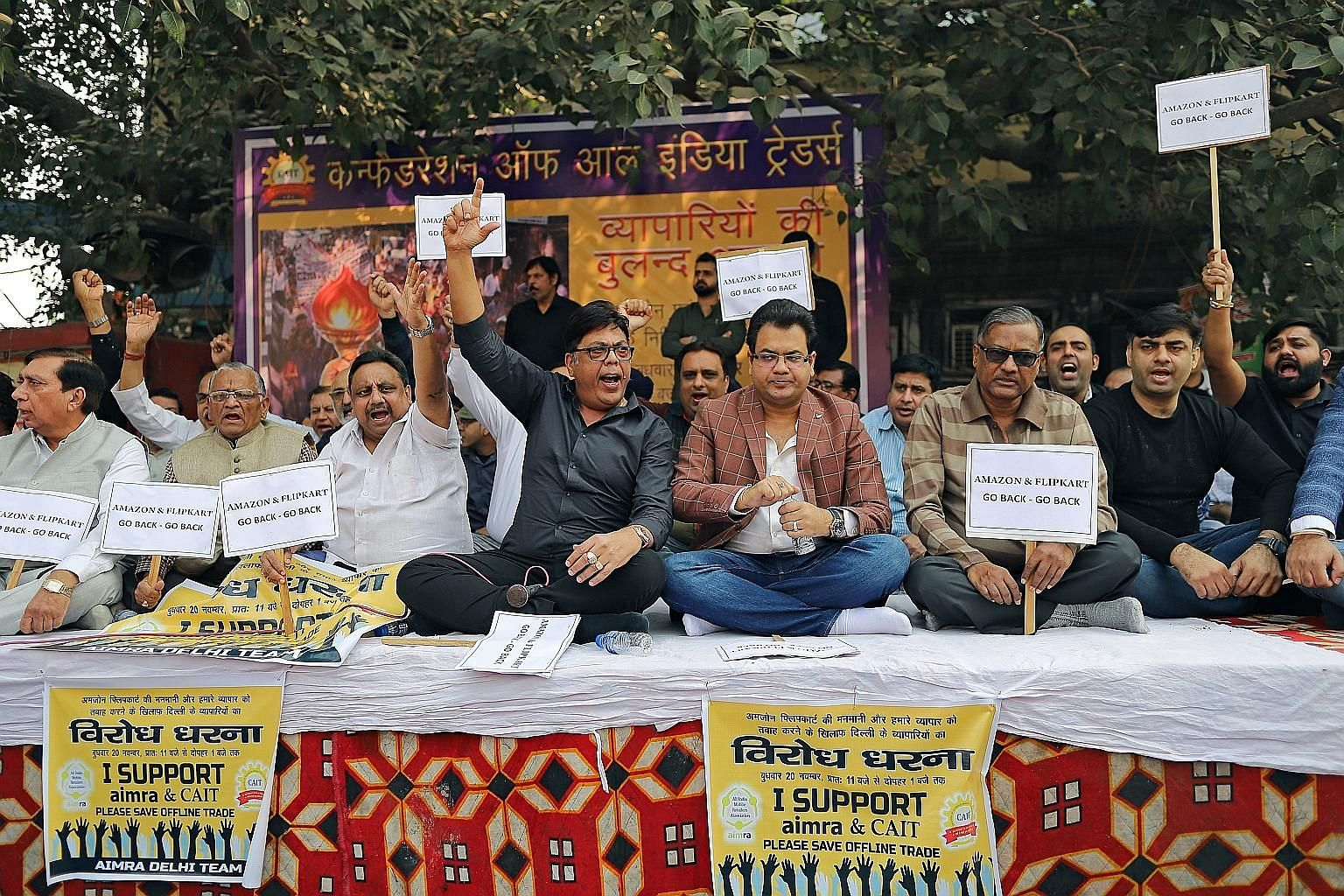Indian merchants holding placards and shouting slogans during a sit-in protest against Amazon and Walmart last month at Sadar Bazaar, the largest wholesale bazaar in New Delhi. This came even as the government in October announced an investigation in
