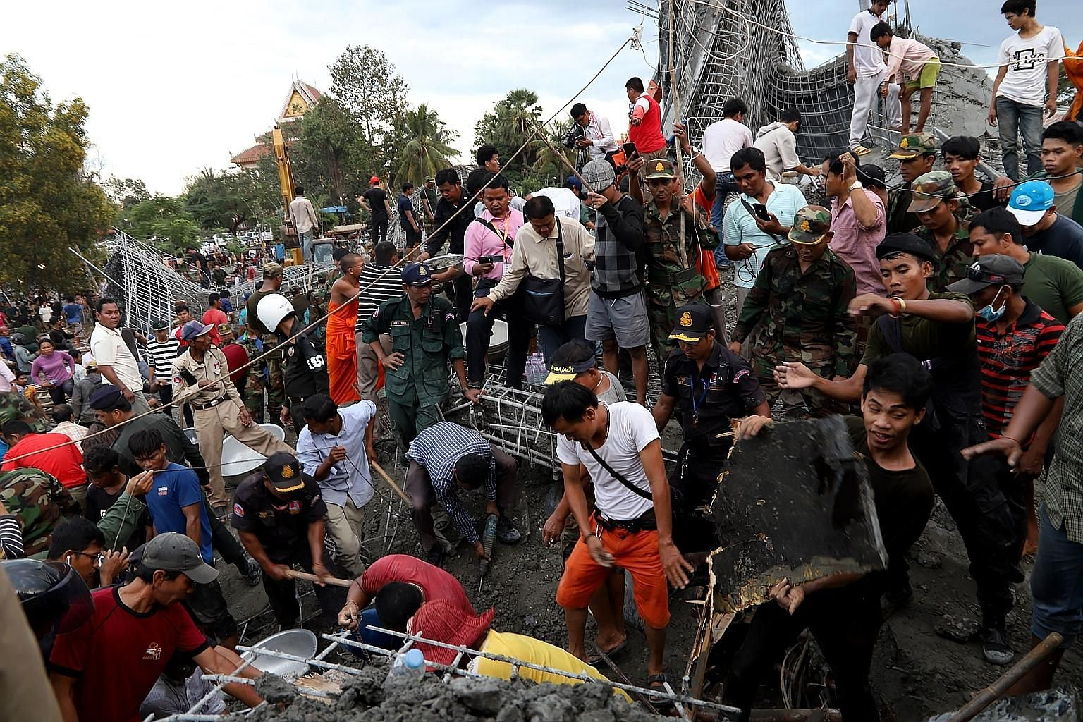 Cambodian rescuers searching for victims on Monday after a Buddhist temple that was being built in Siem Reap collapsed.