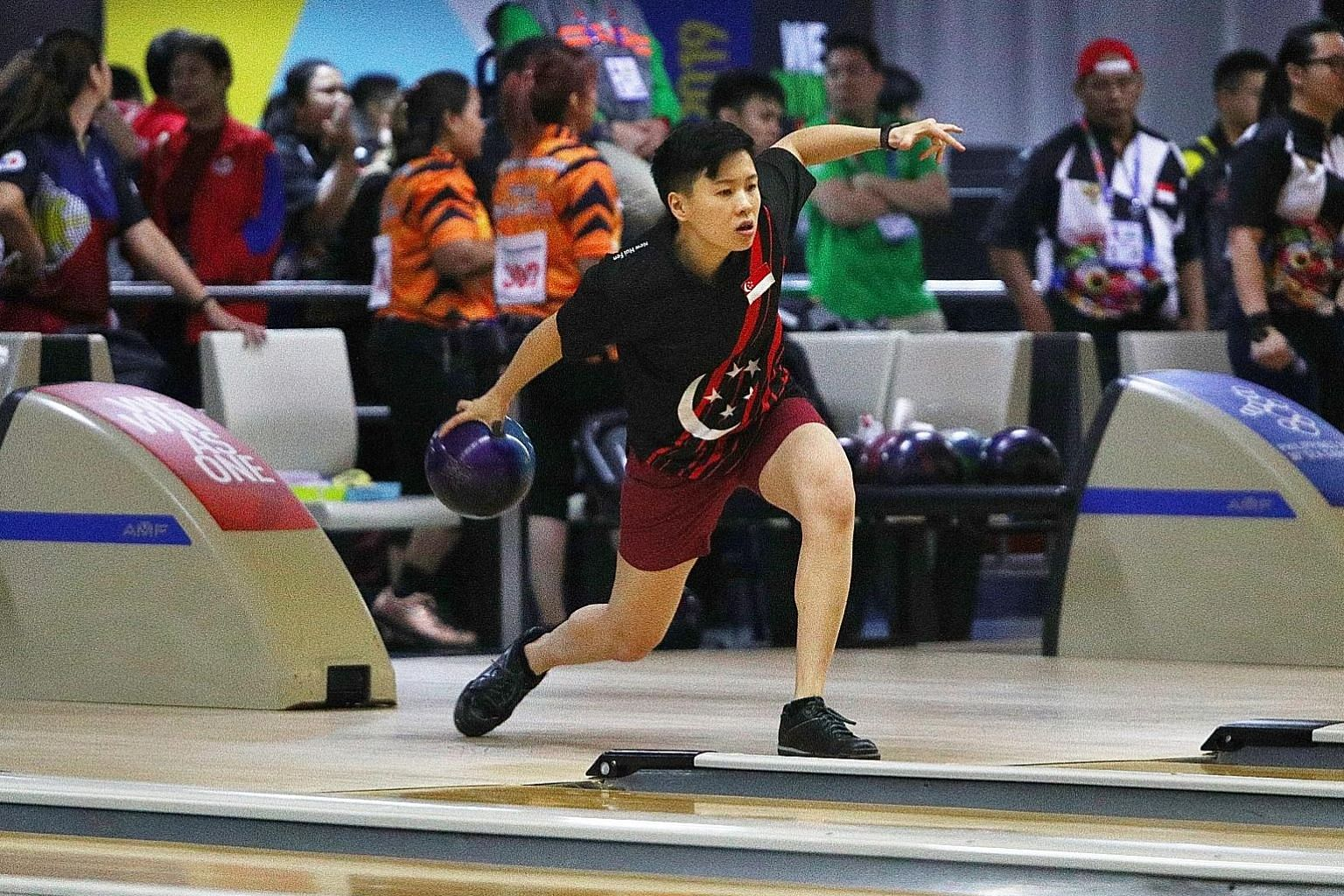 Singapore bowler New Hui Fen pulled away in the fifth game - winning it 235-176 - of the see-saw battle with silver medallist Tannya Roumimper. PHOTO: LIANHE ZAOBAO