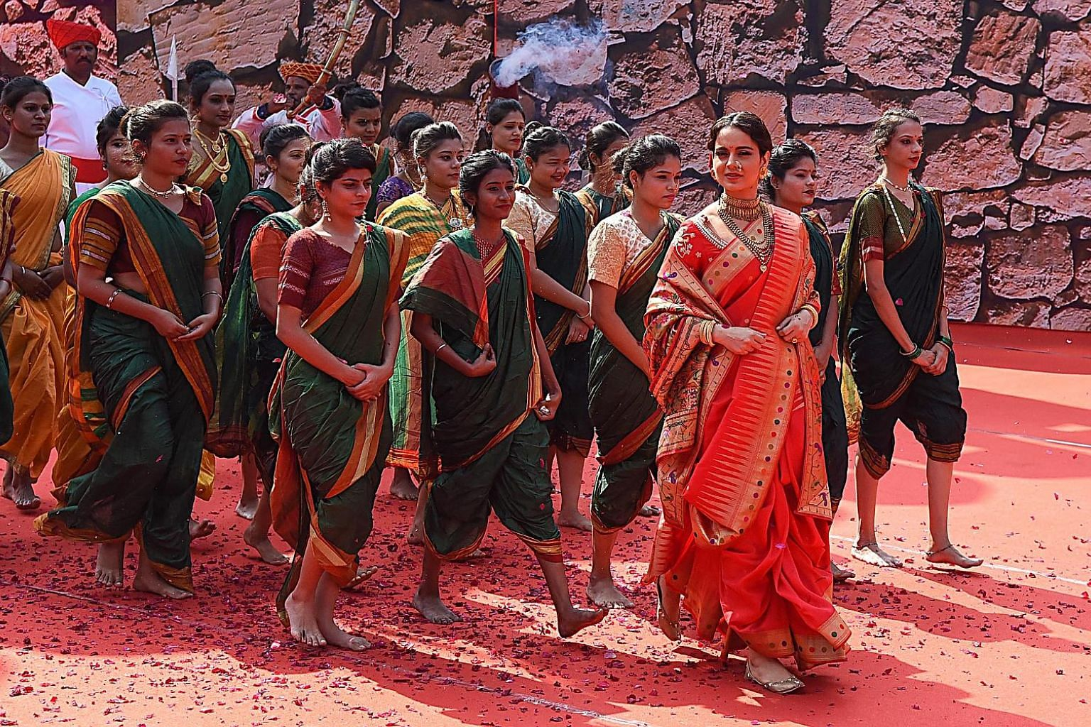 Bollywood star Kangana Ranaut (in red) plays Rani Laxmibai, a 19th-century Indian princess who fought against Britain's colonial army, in the movie Manikarnika: The Queen Of Jhansi. In one scene, soldiers snatch a calf to kill for steak, and Rani res