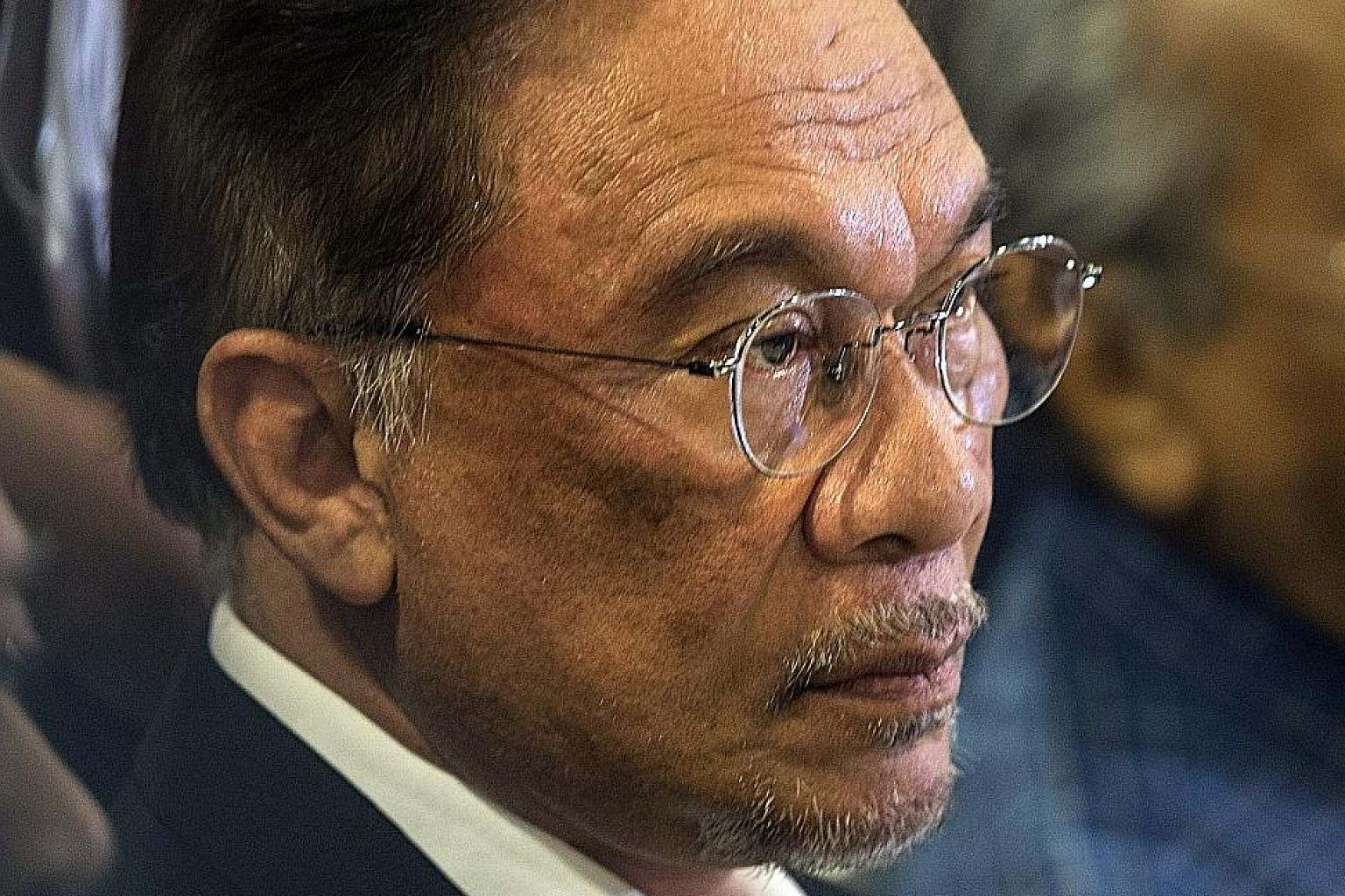 The allegations involving PKR president Anwar Ibrahim (left) were made by his former assistant, Mr Muhammed Yusoff Rawther.