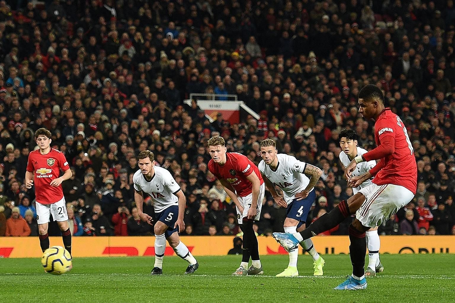 Manchester United striker Marcus Rashford scoring a penalty and his team's second goal, which turned out to be the winner, at Old Trafford on Wednesday night. The Red Devils defeated Tottenham 2-1 in the Premier League as Spurs' new manager Jose Mour