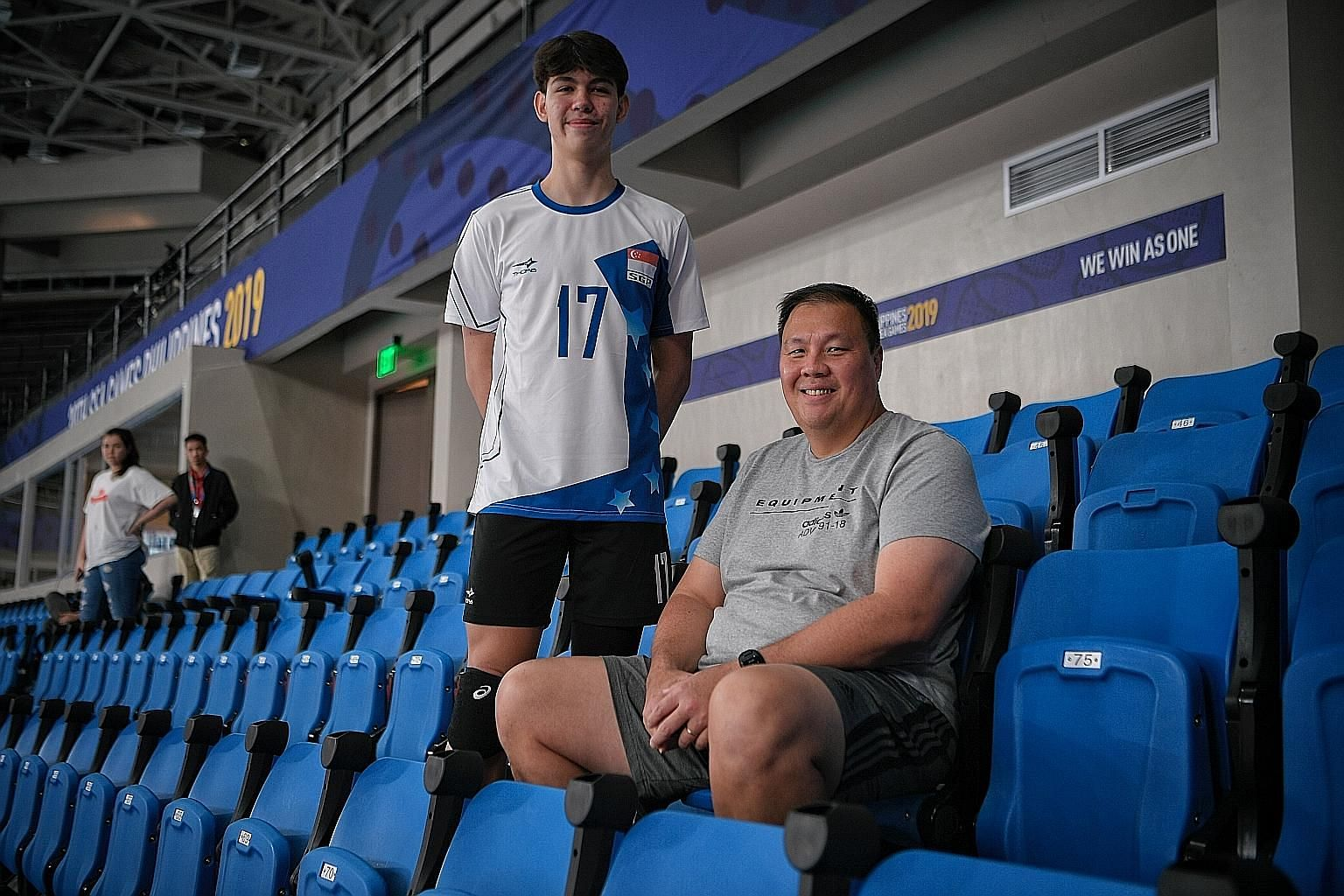 James Wong, who won the discus gold for nine straight SEA Games, and his son Jordan, 16, who is representing Singapore in volleyball in the Philippines.