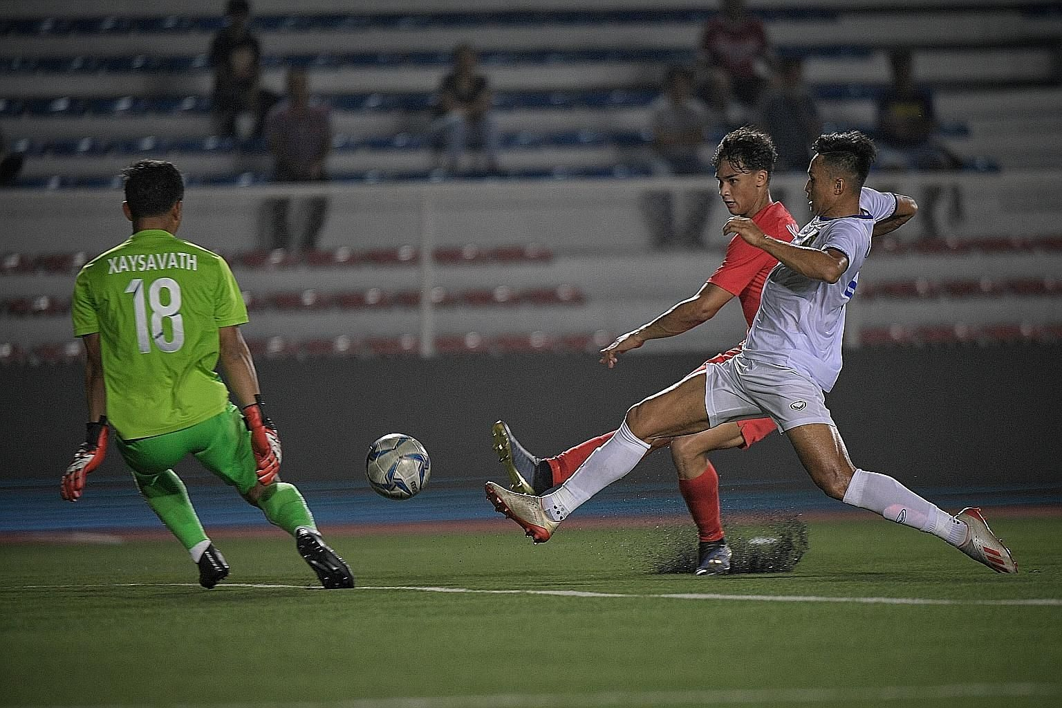 Striker Ikhsan Fandi, son of Singapore Under-22 coach Fandi Ahmad, trying to score against Laos in a 0-0 draw. After the disappointing start, they suffered three straight defeats - against Indonesia, Thailand and Vietnam - before beating Brunei 7-0 y