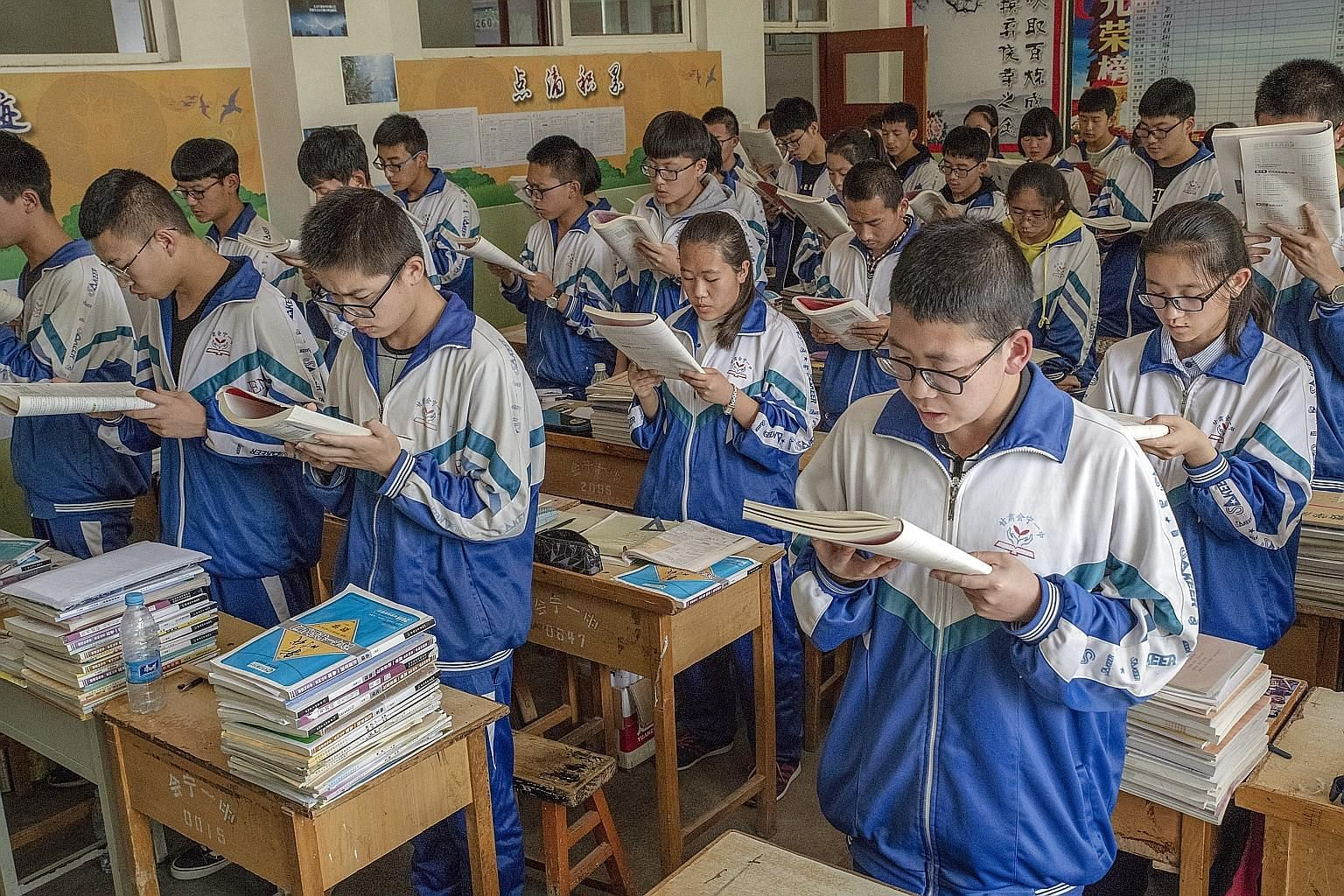 Students reading aloud at Ruining No. 1 High School in China's north-western Gansu province. Experts say that education in the country's eastern region is far better developed than in its western and central regions.