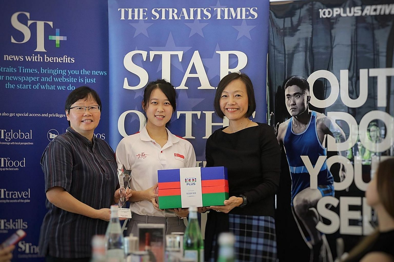 ST sports editor Lee Yulin (left) and F&N Foods managing director Jennifer See presenting Tessa Neo with the ST Star of the Month award yesterday. The shooter was the first Singaporean to win a medal in the women's 10m air rifle at the Asian Shooting