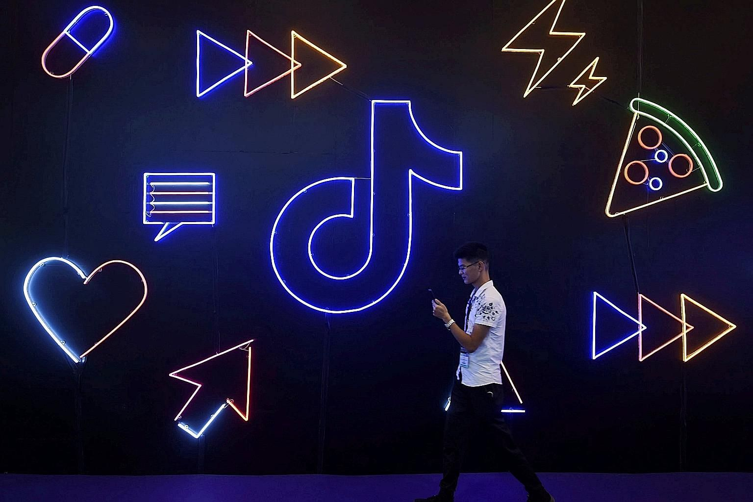 Mobile app TikTok's logo on display at an expo in Hangzhou, China, in October. TikTok's blunder in temporarily taking down a video of 17-year-old Feroza Aziz criticising China's inhumane treatment of Uighur Muslims inflamed suspicions about the inten