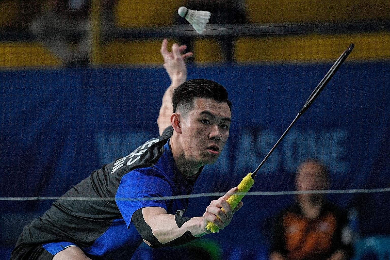 Malaysia's Lee Zii Jia returning to Singapore's Joel Koh during their last-16 match in Manila on Thursday. He won 21-17, 21-10.