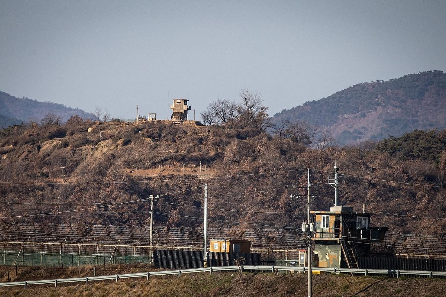 A South Korean sentry post (foreground) and a North Korean one facing each other across the border in Paju, Gyeonggi-do, South Korea. Activity at the North's Sohae rocket launch facility includes what appears to be a newly arrived shipping container