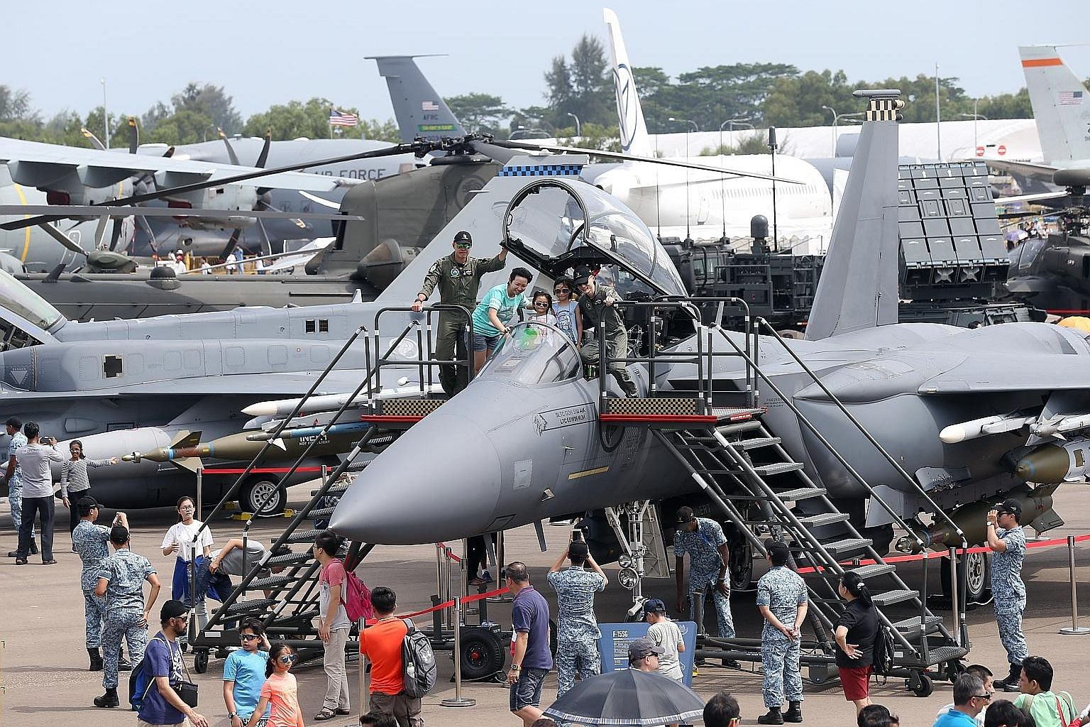 One of the highlights of last year's Singapore Airshow was the chance for attendees to sit in the cockpits of fighter jets. This year's event expects around 65 top aerospace and defence firms at Asia's largest aerospace show. ST FILE PHOTO