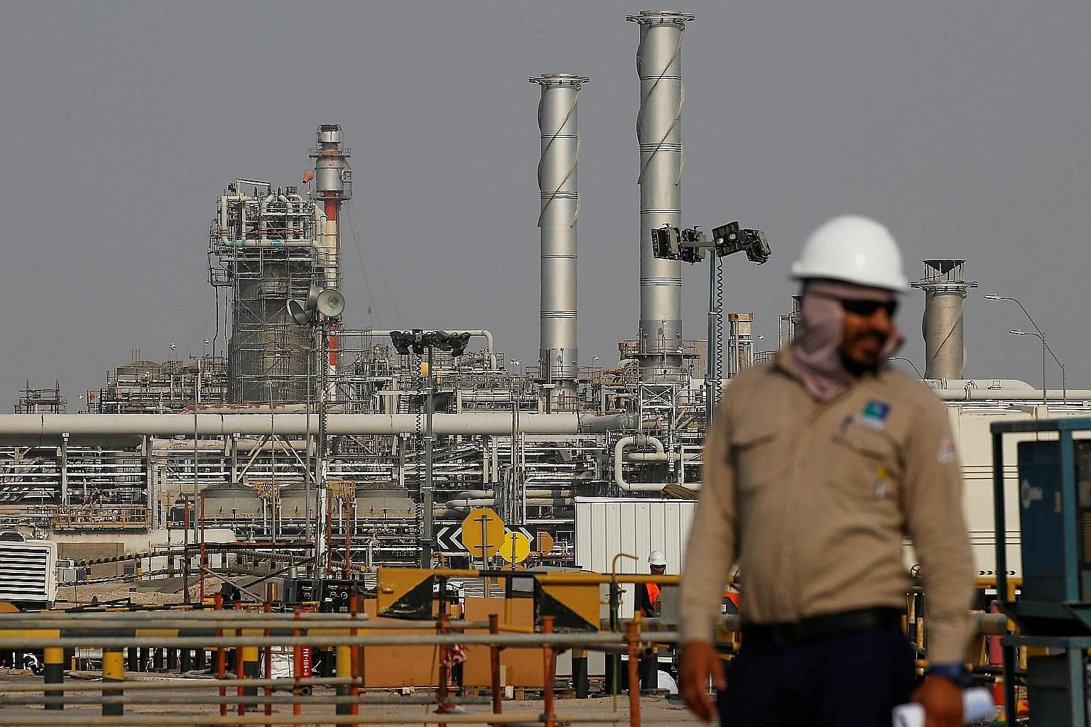 A Saudi Aramco oil facility in Abqaiq, Saudi Arabia. Aramco priced its IPO at 32 riyals per share, the top of its indicative range, the firm said. At that level, it has a market valuation of US$1.7 trillion, comfortably overtaking Apple as the world'