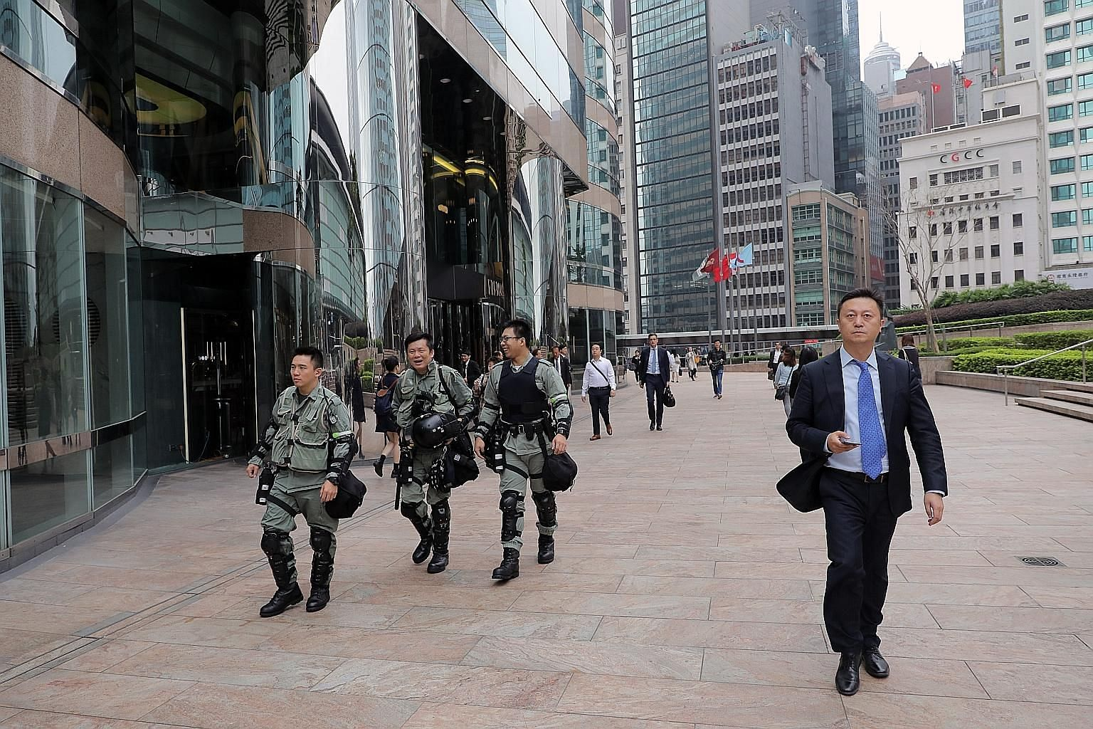 Riot police outside the Exchange Square complex, which houses the Hong Kong Stock Exchange, on Nov 26. The Hong Kong government expects to run a rare budget deficit this fiscal year, amid months of political unrest, as the cost of its fiscal measures