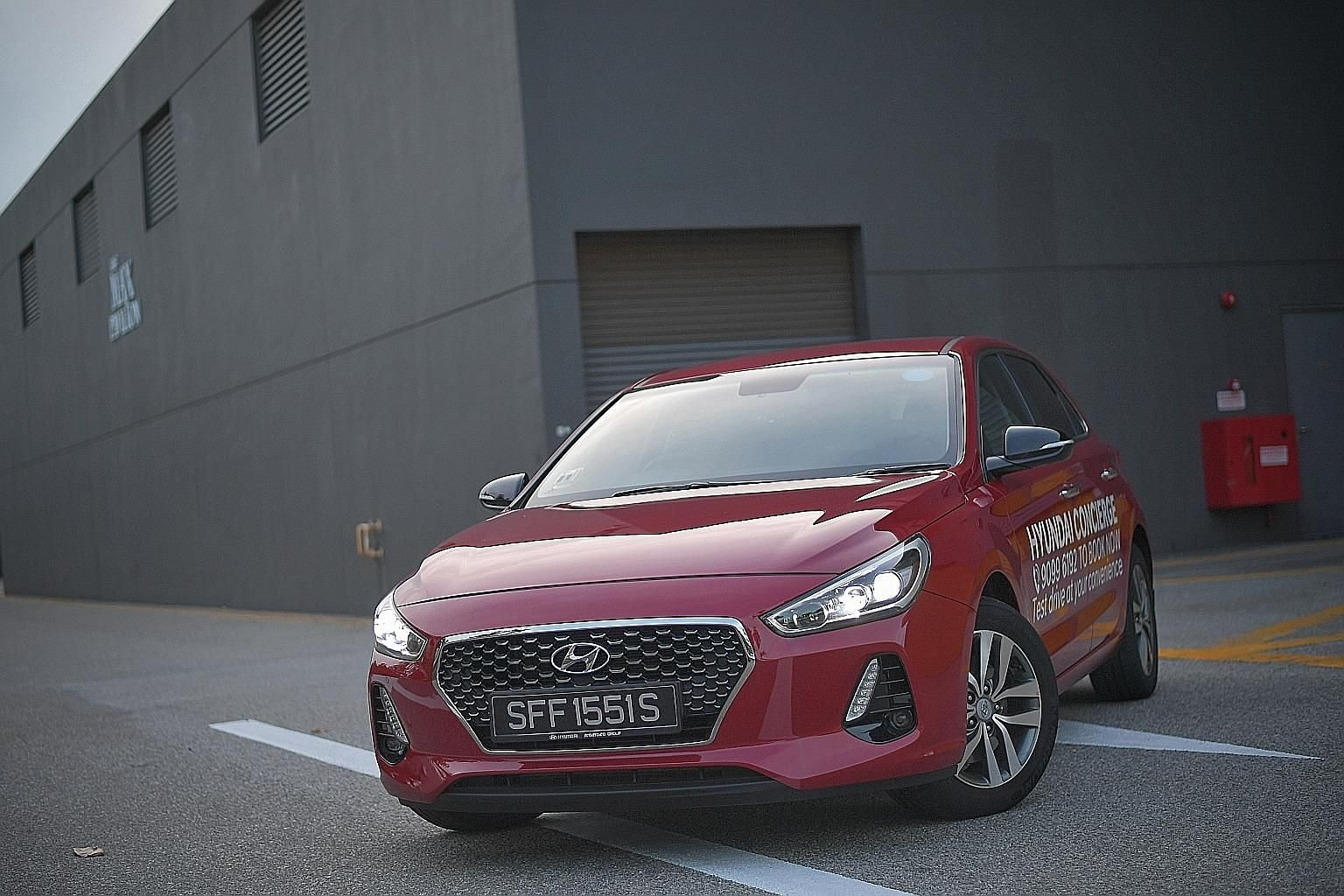The updated Hyundai i30 hatchback has more frills, including paddle shifters, LED cornering lights, additional airbags and tyres that come with deflation warning.