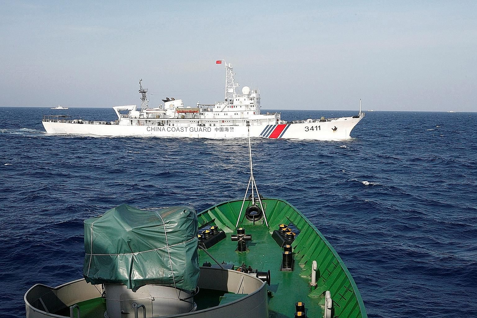 A 2014 file photo showing a China Coast Guard vessel near a Vietnam Marine Guard ship in the South China Sea, about 210km off Vietnam. In some Asean countries like the Philippines and Vietnam, nationalism that used to be defined in anti-US terms now