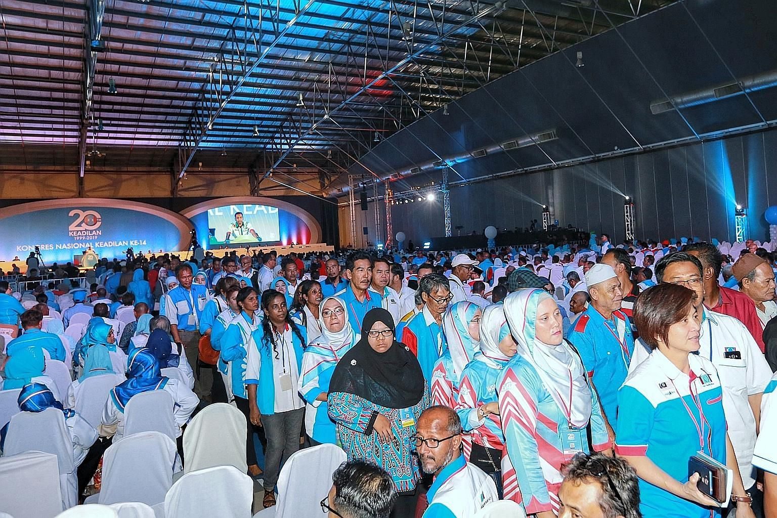 Parti Keadilan Rakyat members allied to deputy president Azmin Ali leaving the event hall where the congress was held yesterday. In a press conference after the walkout, Mr Azmin said party president Anwar Ibrahim's policy address paved the way for d
