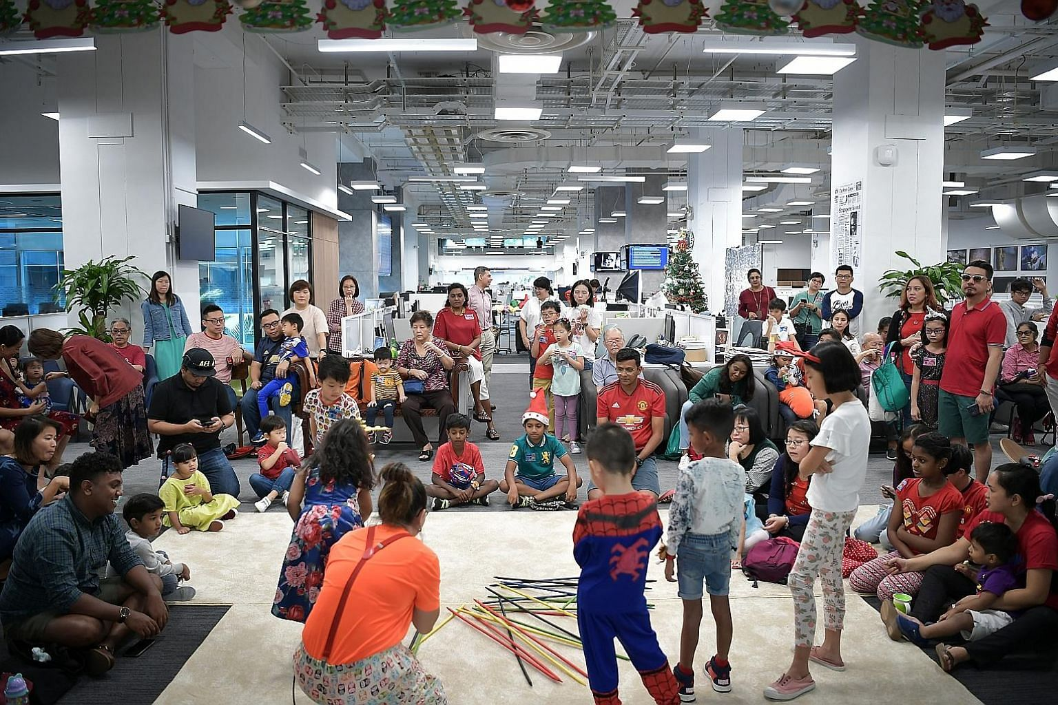 Children of The Straits Times staff got the opportunity to see where their parents work, as well as enjoy treats such as candy floss, popcorn and ice cream from a pushcart, at the year-end celebration and Christmas party yesterday. There was also a b