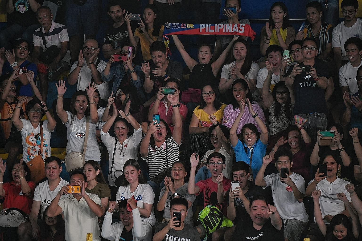 Spectators cheering during the badminton matches at the Muntinlupa Sports Complex in Manila on Thursday. ST PHOTO: MARK CHEONG