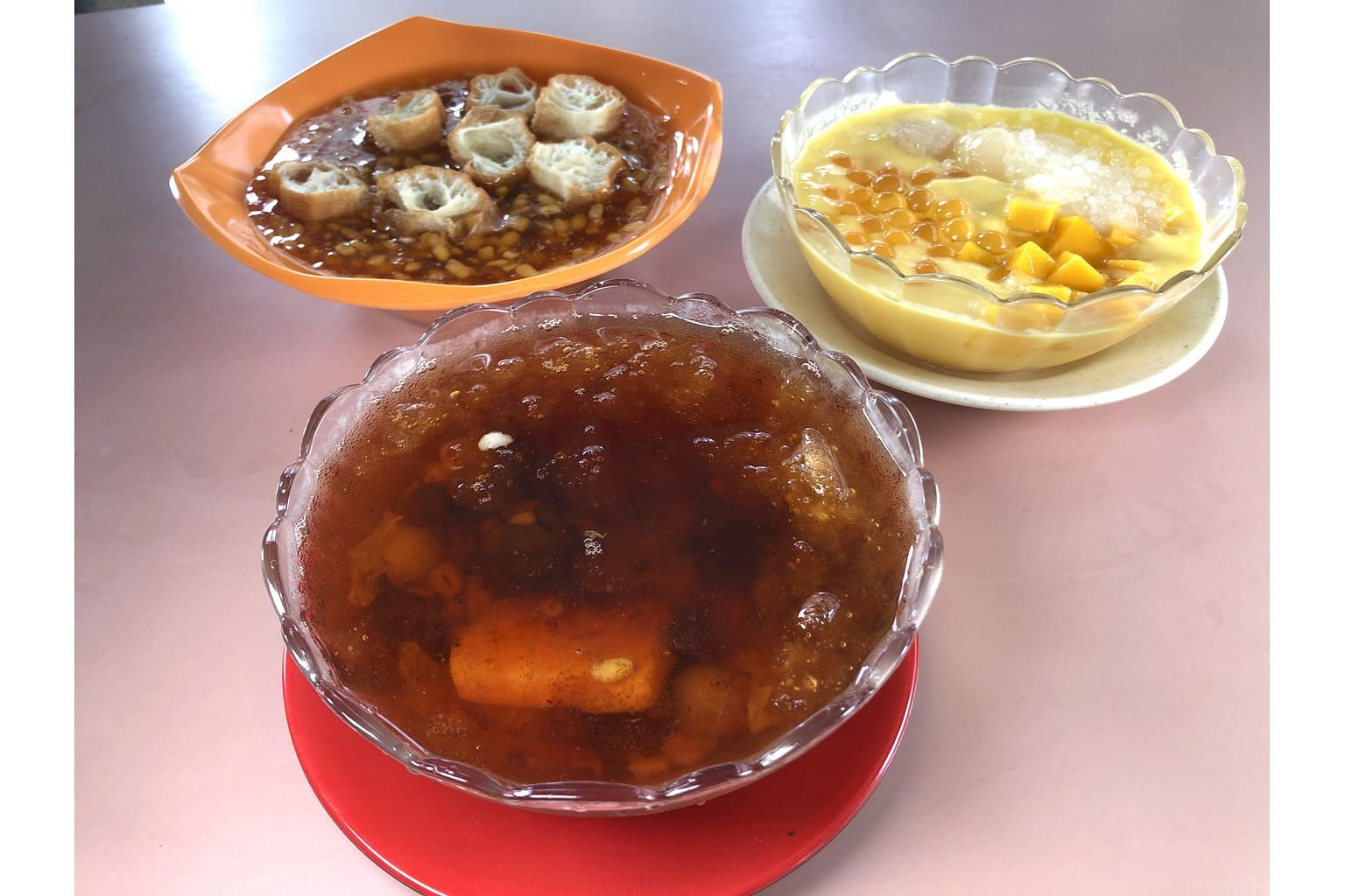 Shirley Jie Desserts offers value for money with its (clockwise, from top left) tau suan, mango sago and cheng tng.