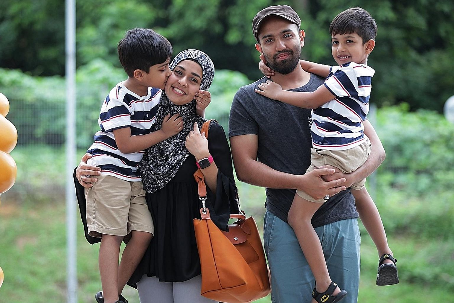 Housewife Aswin Jamee Mohamed Ameerdin and her husband, Mr Mohamed Azhar, with their sons, Ahmad Irfan (far left) and Ahmad Zishan, beneficiaries of the North West Community Development Council's bursary programme for pre-schoolers. ST PHOTO: GIN TAY