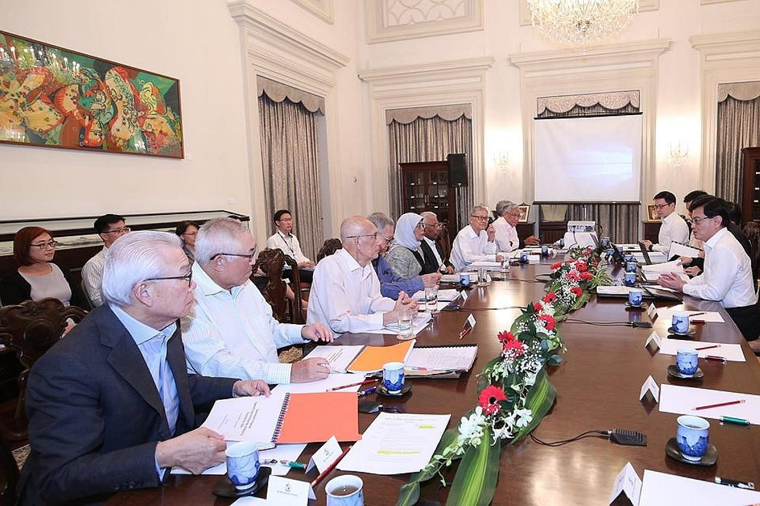 President Halimah Yacob being briefed by Deputy Prime Minister and Finance Minister Heng Swee Keat and officials from the Ministry of Finance last week. Also present were the Council of Presidential Advisers and representatives from GIC, the Monetary