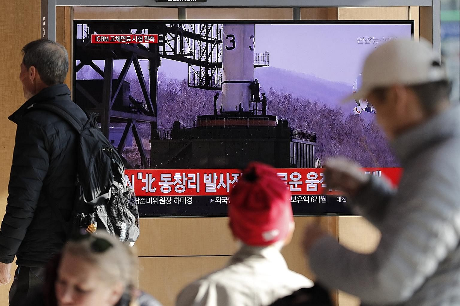 """A TV news bulletin at a Seoul railway station yesterday showing a file image as it reported on North Korea's announcement that it had carried out a """"very important test"""" at the Sohae Satellite Launching Ground, a site that has been used to launch sat"""