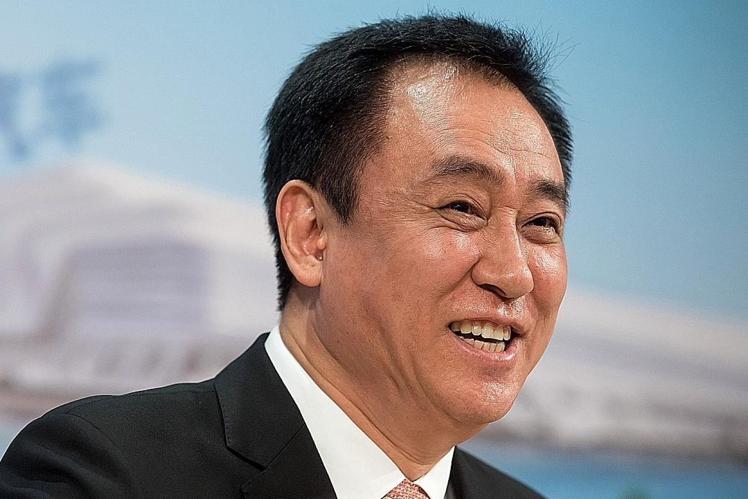 Mr Hui Ka Yan has a 78 per cent stake in China Evergrande Group, which has declared a record dividend.