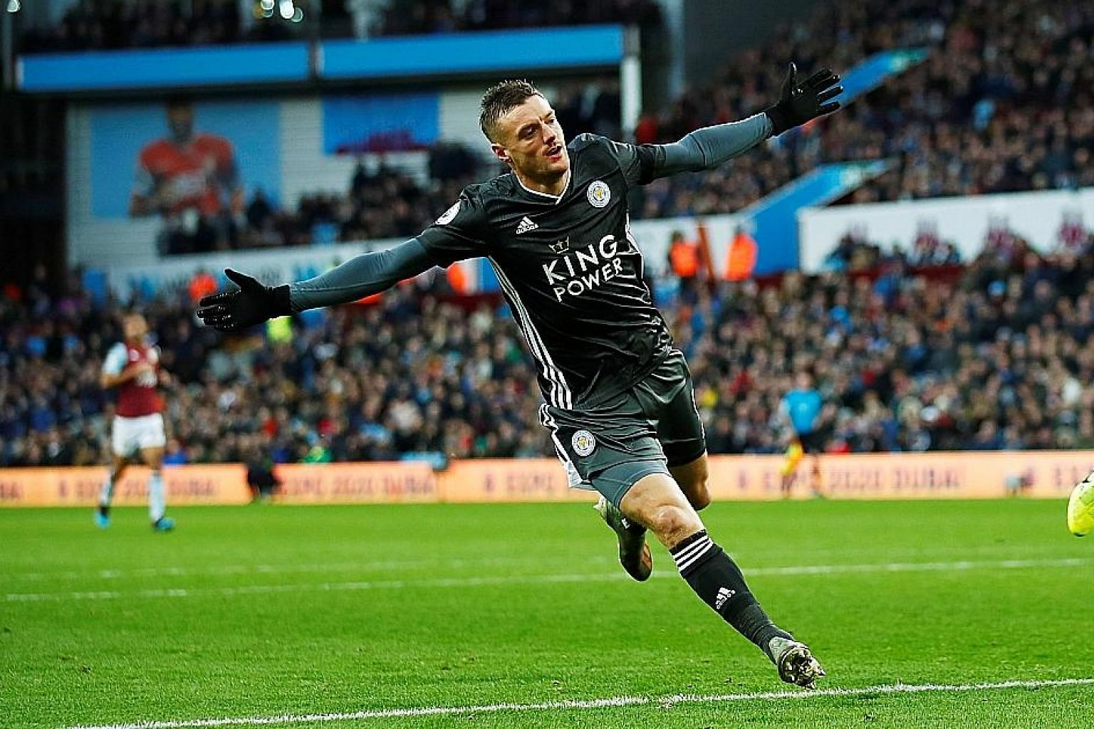 Jamie Vardy wheeling away after rounding off Leicester's 4-1 league win over Aston Villa at Villa Park on Sunday with his second goal.