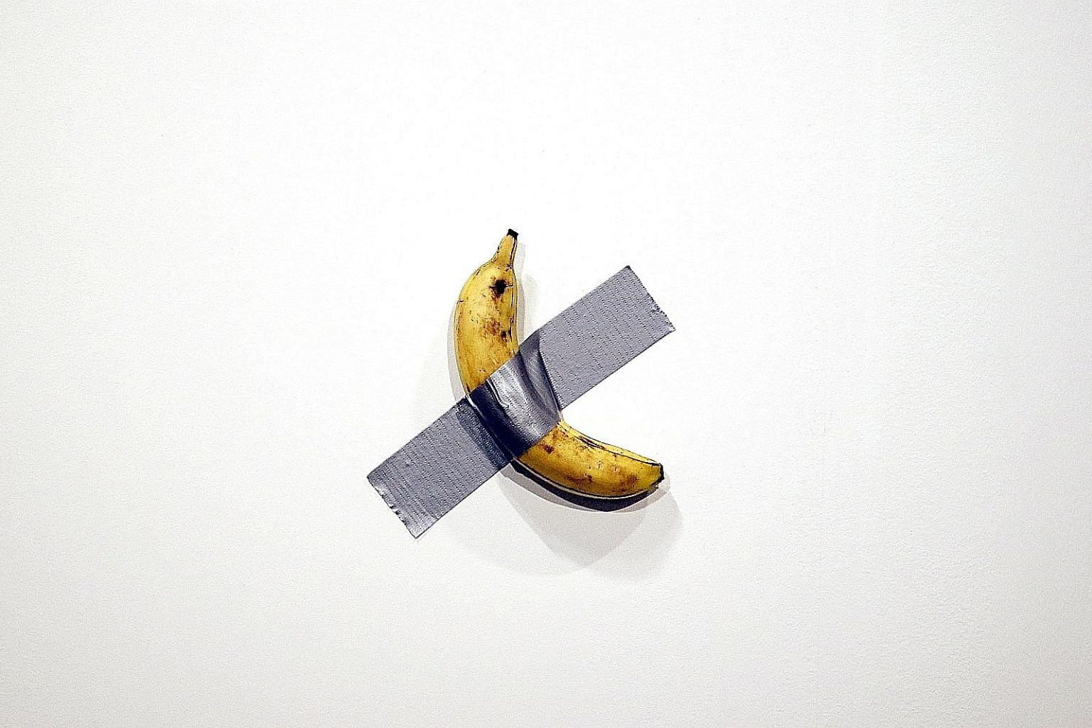 Artist Maurizio Cattelan's piece, Comedian (a banana duct-taped to the wall), was torn from the wall and eaten last week at Art Basel Miami Beach.