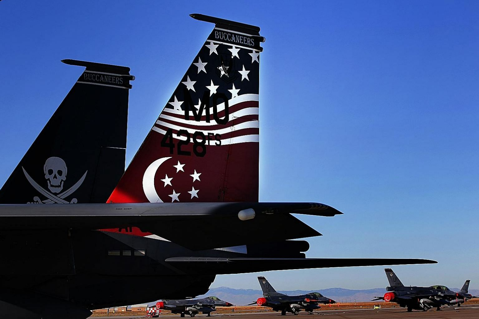 Singapore's F-15SG and F-16 fighters at Mountain Home Air Force Base in Idaho. Repatriating RSAF assets will take 6.5 hours from Guam, compared with several days required to bring home ConUS fighters across the Pacific.