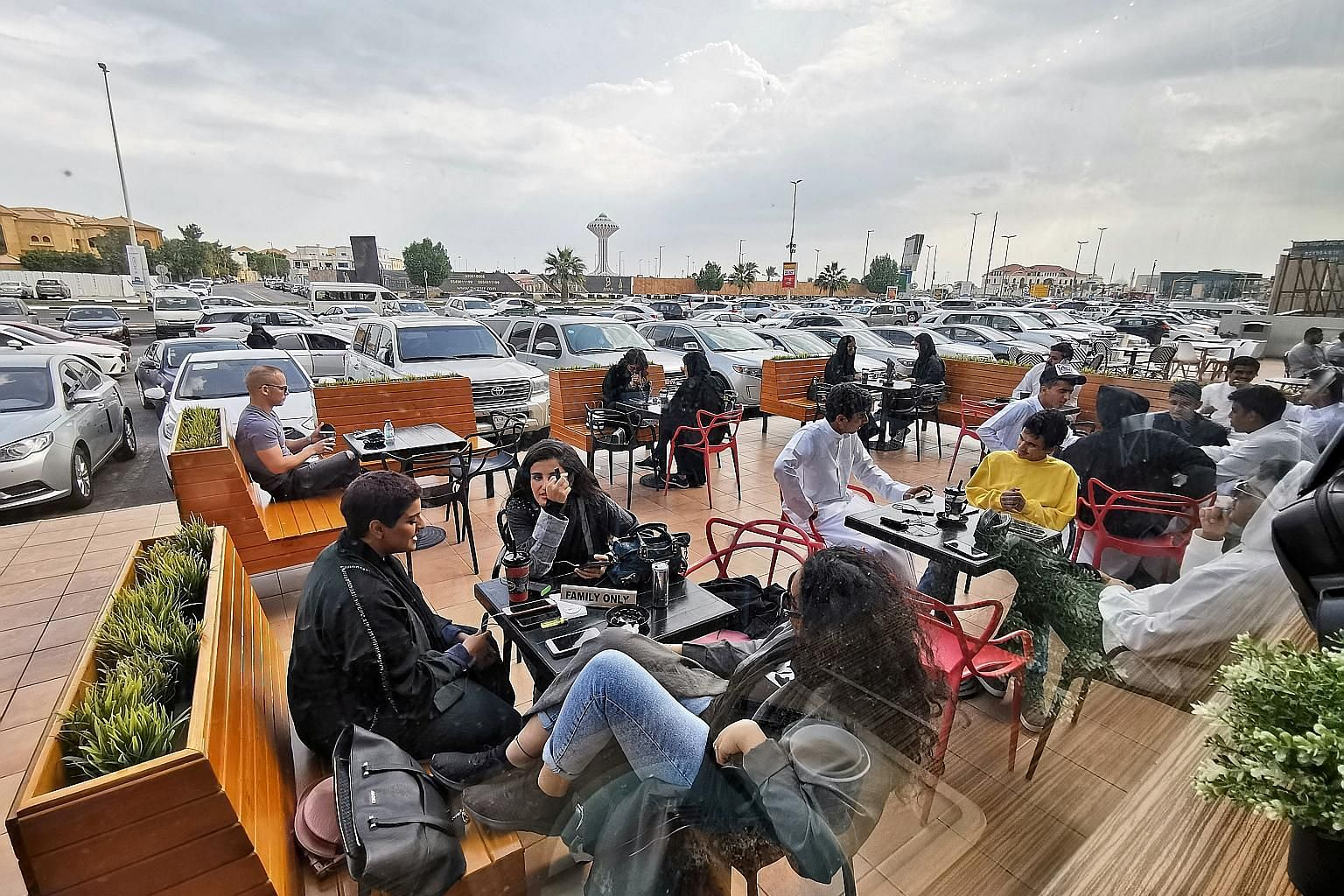 Men and women at a cafe in Khobar, Saudi Arabia, yesterday. Many restaurants and cafes in the country have separate entrances for women and partitions or rooms for families where women are not visible to single men.
