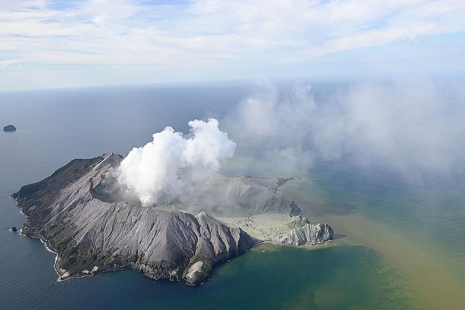 Plumes of smoke rising after White Island volcano erupted yesterday. Police said there were no more signs of life there after rescue helicopters and other aircraft conducted a number of aerial reconnaissance flights. Tourists fleeing New Zealand's Wh