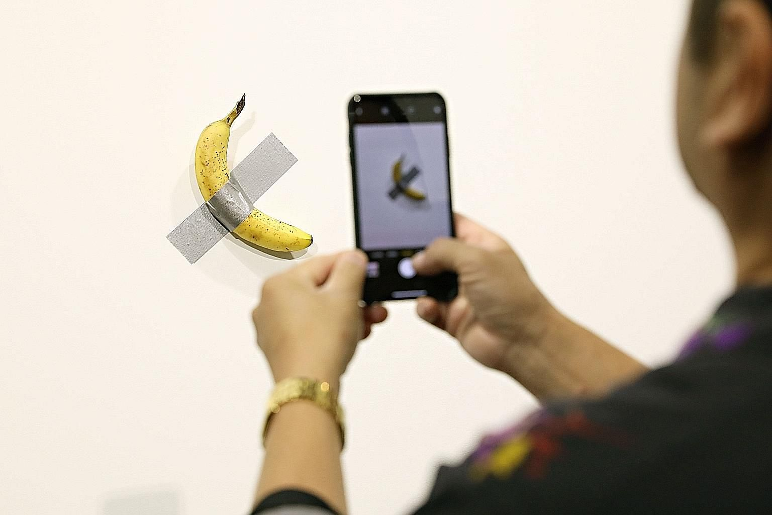 """Maurizio Cattelan's Comedian at Art Basel Miami in Miami Beach, Florida, last Friday. Establishments such as local durian shop 99 Old Trees (left) and US-based online accessories shop Urban Bling (left below) posted their own spoofs, with a """"durian p"""